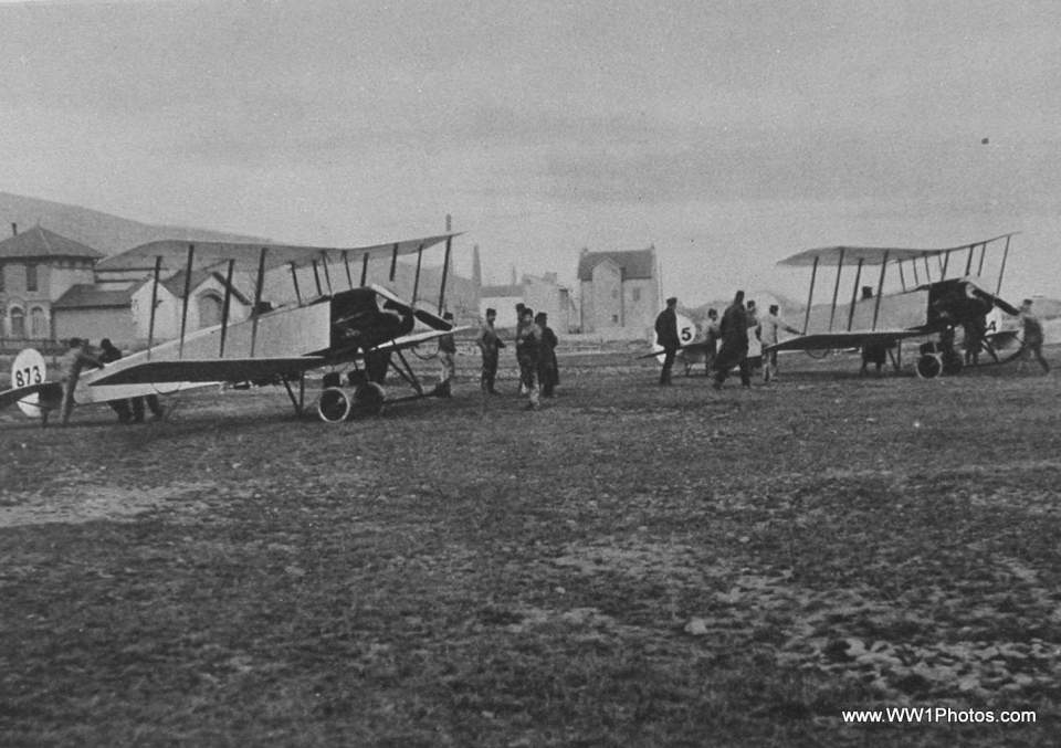 British biplanes. http://ww1photos.com/images/Website/British_Biplanes_About_To_Leave_For_The_Attack_On_The_Zeppelin_Factory_And_Sheds_At_Friedrichshafen.jpg